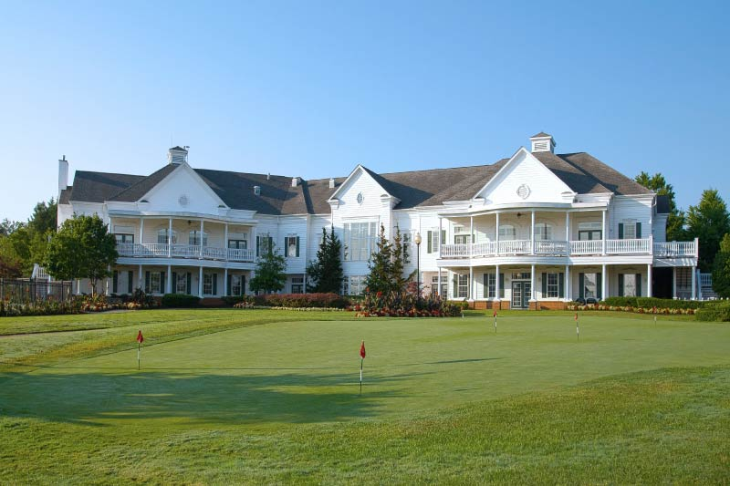 The putting green and clubhouse at the Heritage Hunt 55+ community in Gainesville, Virginia