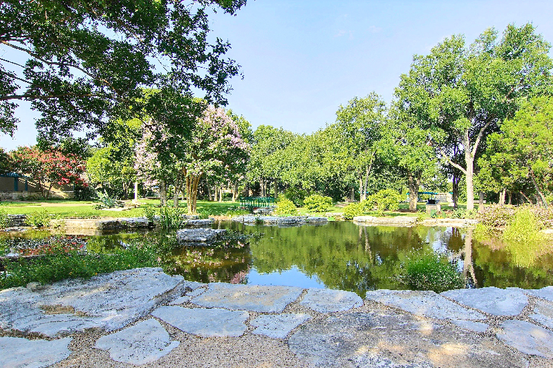 The pond outside of Sun City Texas's Social Center is just one of many amenities available for members to enjoy.