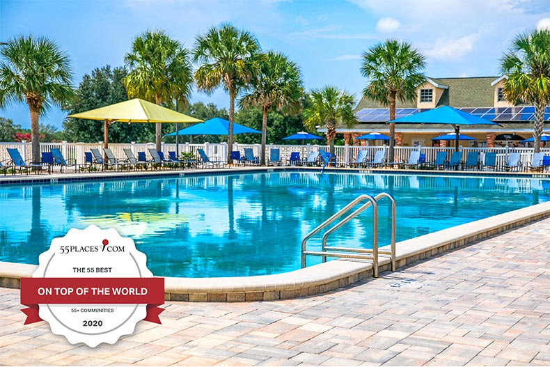 "The outdoor pool at On Top of the World in Ocala, Florida with a ""The 55 Best"" badge"