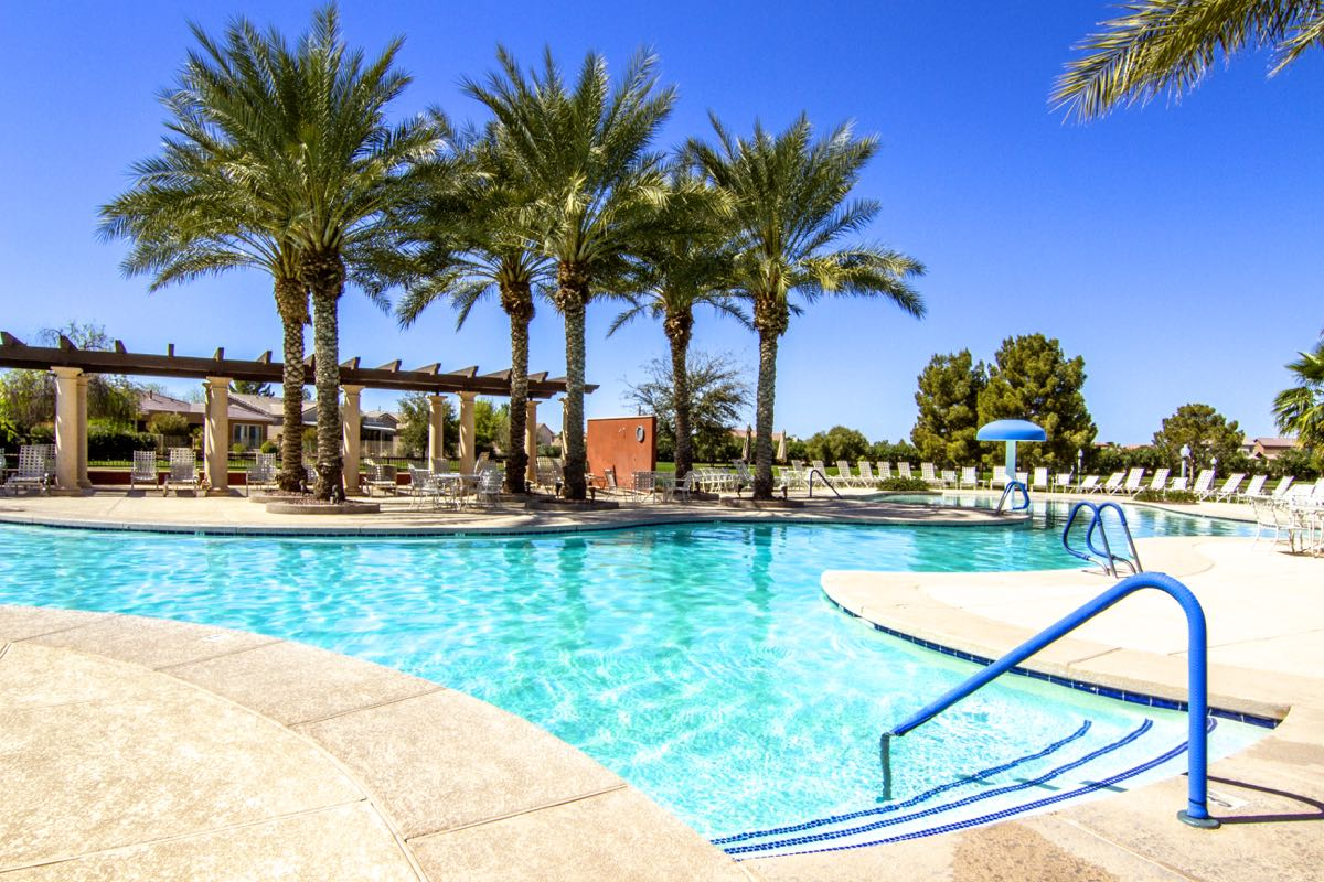 A resort-style outdoor pool is surrounded on three sides by a scenic 50-acre lake.