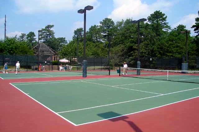 Club Encore, one of the three clubhouses,  includes an outdoor pool and spa, tennis courts and a gazebo