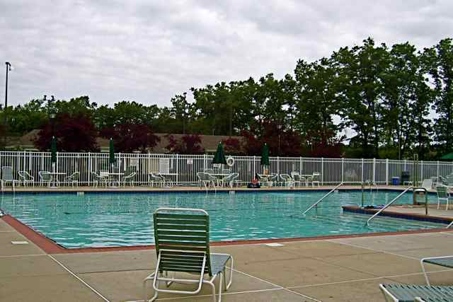 Outdoors, the community offers many more amenities to support an active lifestyle. The outdoor pool provides ample space for swimming or lounging in the sun.