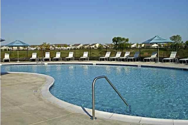 The spacious outdoor swimming pool is a popular resident destination to savor summer days in Illinois.