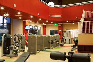 The vibrant fitness center at Del Webb Orlando features state-of-the-art equipment and an indoor walking track.