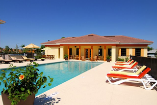 A casual outdoor swimming pool is the perfect spot to relax in the warm Florida sunshine.