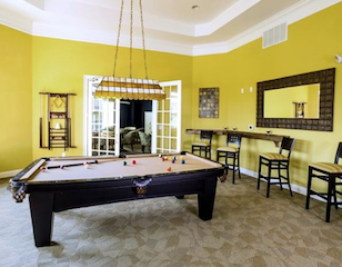 The clubhouse at Woods Landing features inviting spaces to socialize with friends.