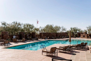 Bellasera residents can relax by the pool on a warm Arizona day or