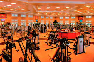 Residents enjoy exceptional amenities including this state-of-the-art fitness center, swimming pools, golf and more.