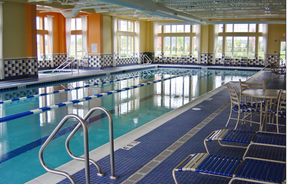 an indoor pool where residents can go for a swim or relax in the adjacent spa after a long day of fun.