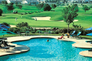 Sun City Huntley offers resort style active adult living including an 18-hole golf course and beautiful outdoor pool.