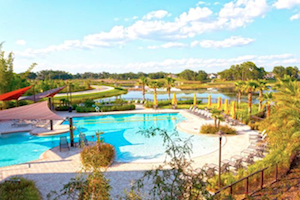 Residents can enjoy the beautiful Florida weather lounging by this large resort-style swimming pool.