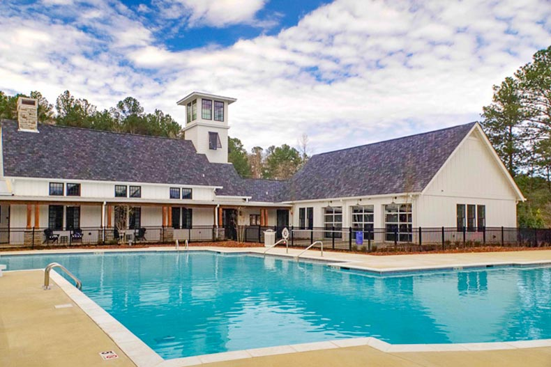 The clubhouse and outdoor pool at Abingdon at Lake Wilborn in Hoover, Alabama