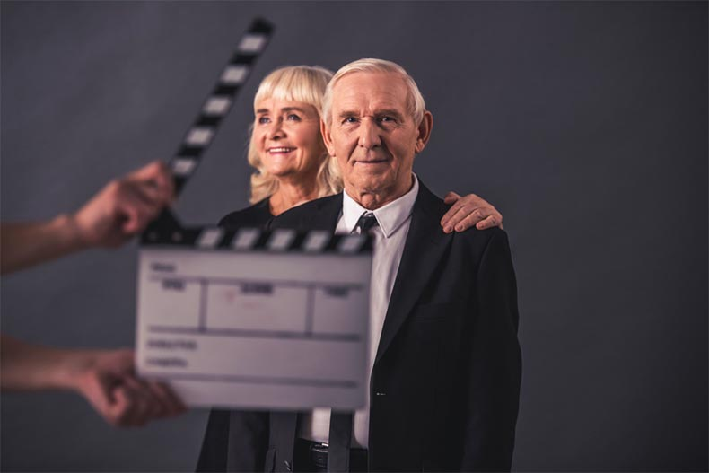 An older couple waiting for a director to should action.