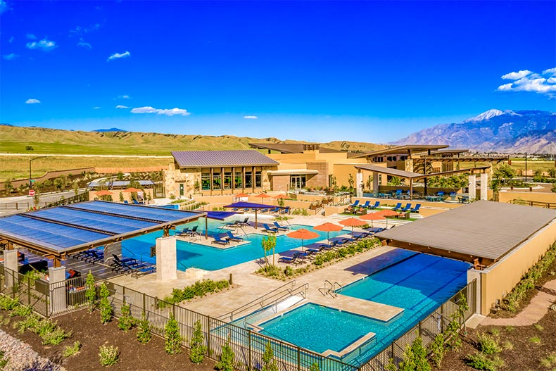 Aerial view of the Altis clubhouses and outdoor pool and patio with mountains in the background