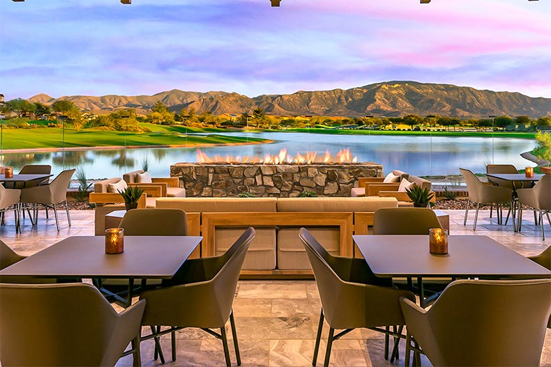 View of a picturesque lake and mountain range from the Ranch House patio at SaddleBrooke Ranch in Oracle, Arizona