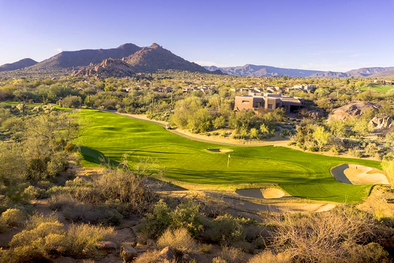 Aerial view of an Arizona golf course with mountains in background