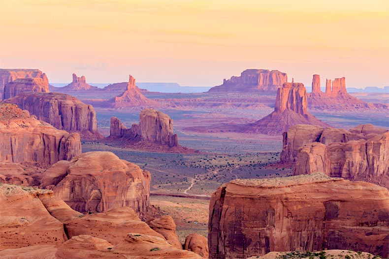 A sunrise over Hunts Mesa in Monument Valley, Arizona