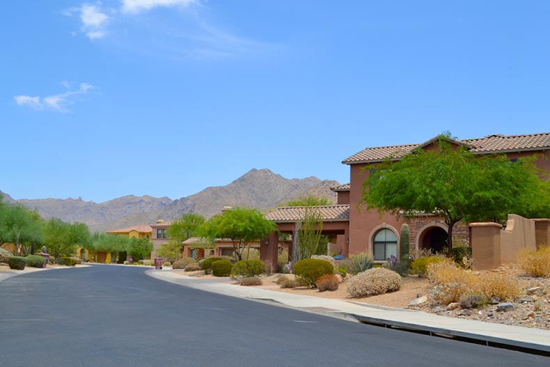 A blue sky over a Southwestern-style neighborhood in the mountains of the Arizona desert
