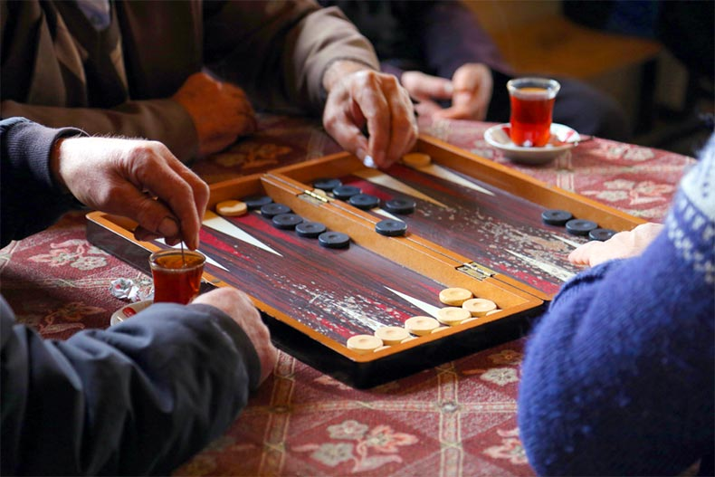 People playing a game of backgammon