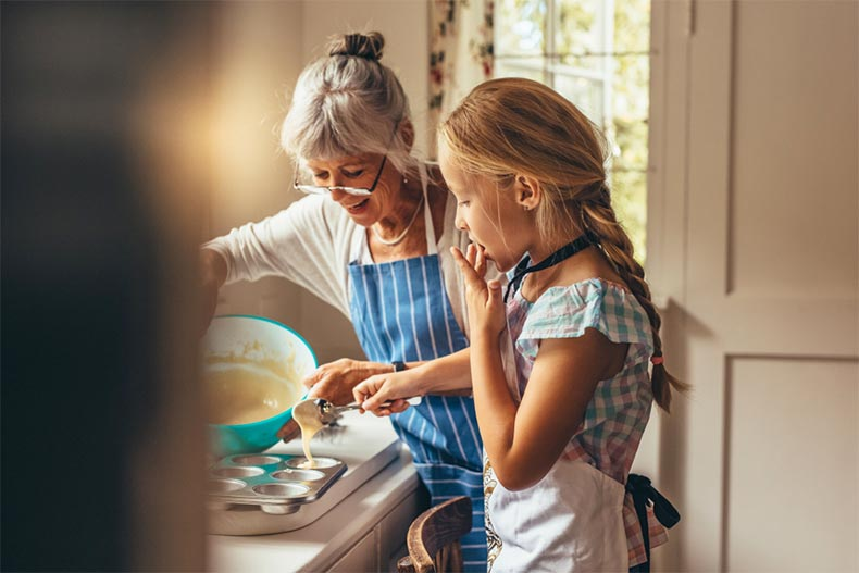 Grandmother baking with her young grandaughter