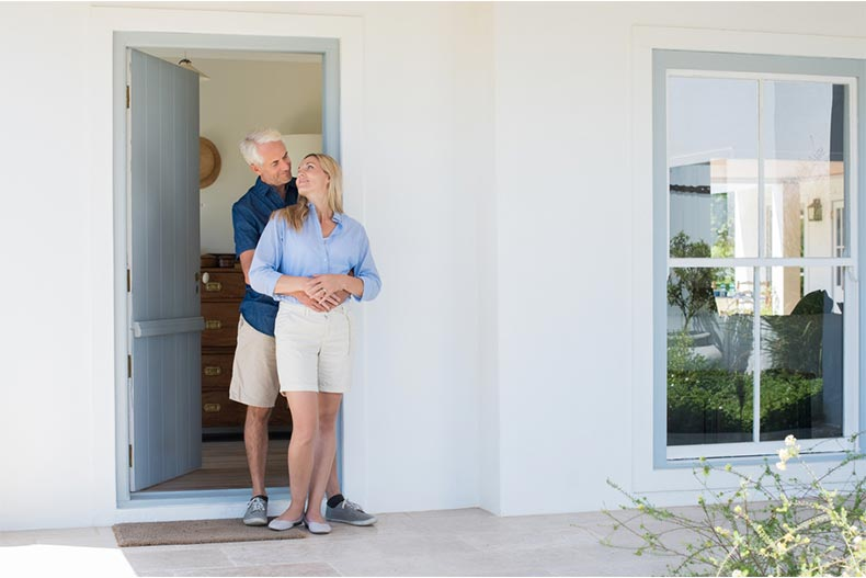 A happy active adult couple embracing after closing on their new home