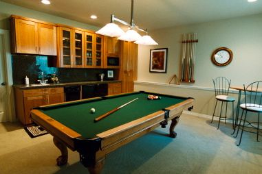 A den or basement is a great area for men to socialize with their friends, watch TV, play poker or pool, or just carve out some time on their own.