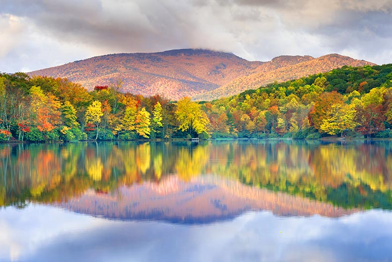Photo of the Blue Ridge Mountains of North Carolina reflected on a lake in the Valley