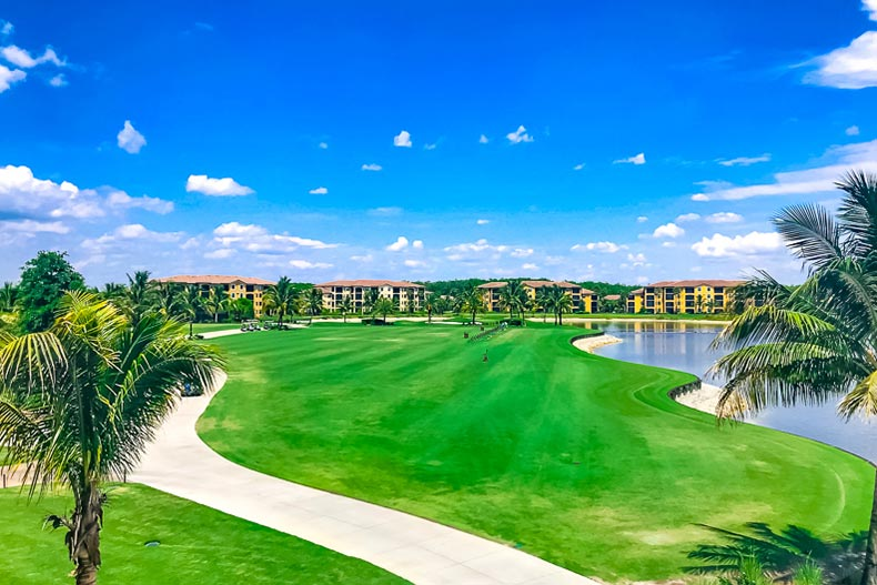 View of the golf course, condo buildings, and pond at Bonita National Golf & Country Club in Bonita Springs, Florida