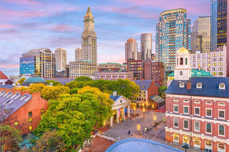 Boston skyline at dusk with Faneuil Hall and Quincy Market in view