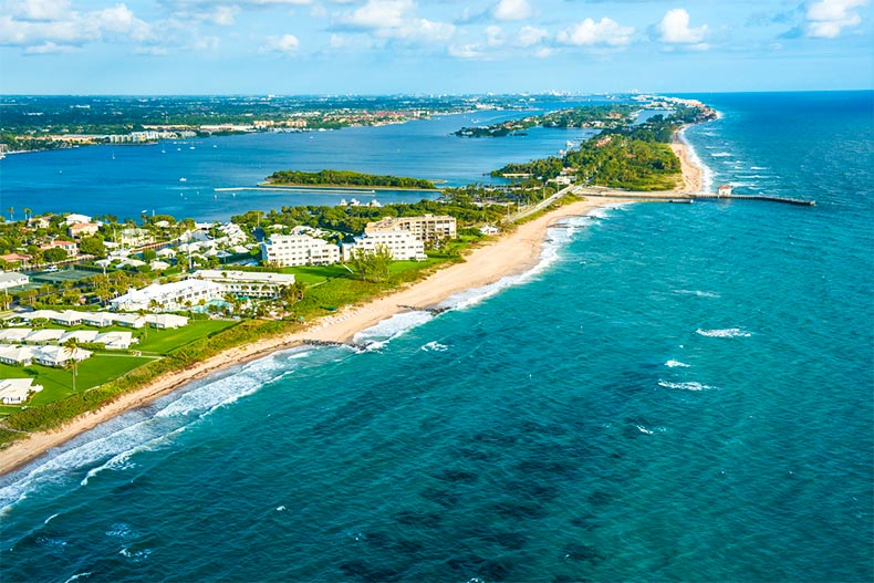 Aerial view over water of the shore of Boynton Beach and intracoastal waterway