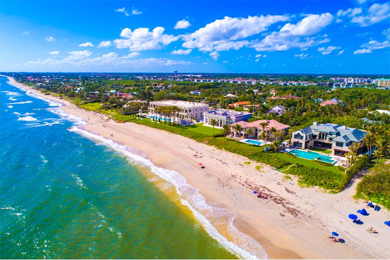 Aerial view of luxury homes on shores of Atlantic Ocean in Boynton Beach