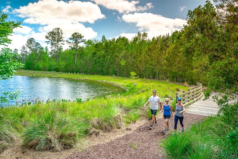 Residents walking along a nature trail in Brunswick Forest in Leland, North Carolina