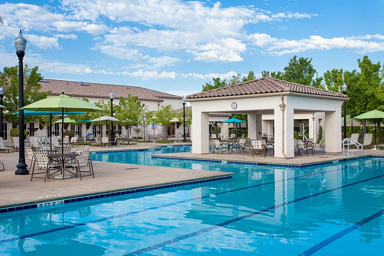 Blue sky over the outdoor pool and patio at Heritage Park in Sacramento, California