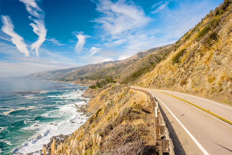 Blue sky over a stretch of Highway 1 along the Pacific coast in California