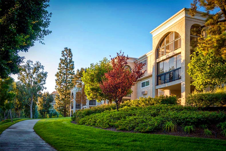 View of a walking trail leading to a condo building at Laguna Woods Village in Laguna Woods, California