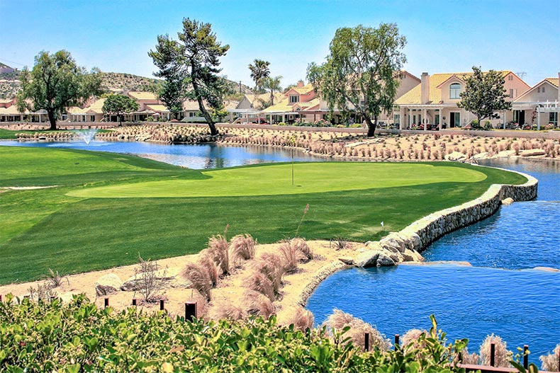 View of a small river with a golf course on one side and homes on the other at Sun Lakes Country Club in Banning, California