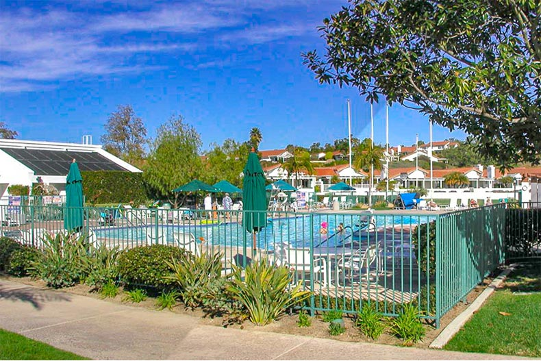 View of the outdoor pool and patio at Ocean Hills Country Club in Oceanside, California