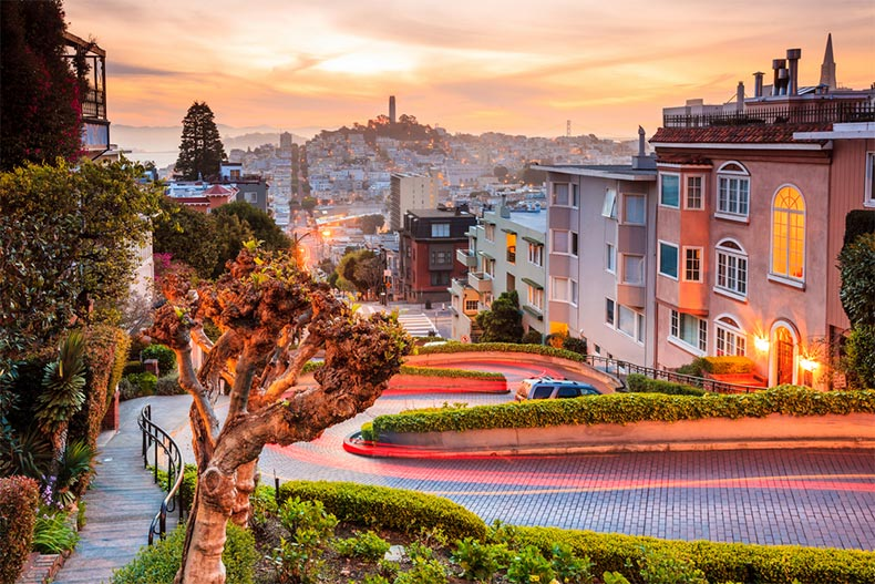 Time-lapse photo of Lombard Street in San Francisco at sunrise