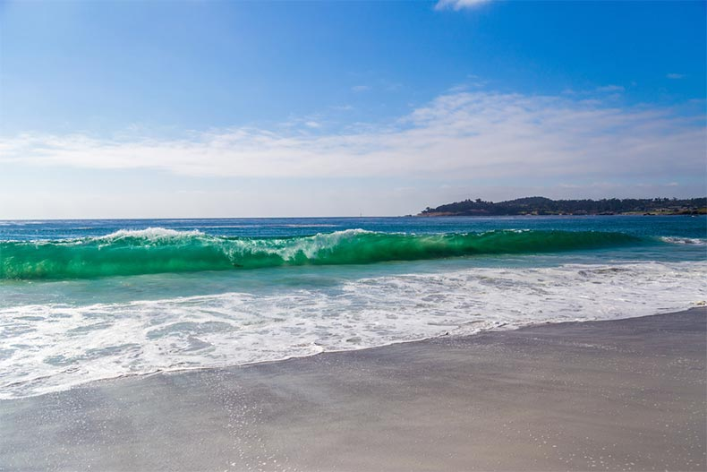 Ocean waves crashing on the shore at Carmel-by-the-Sea, California