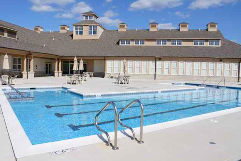 View of the outdoor pool and patio at Carillon at Cambridge Lakes in Pingree Grove, Illinois