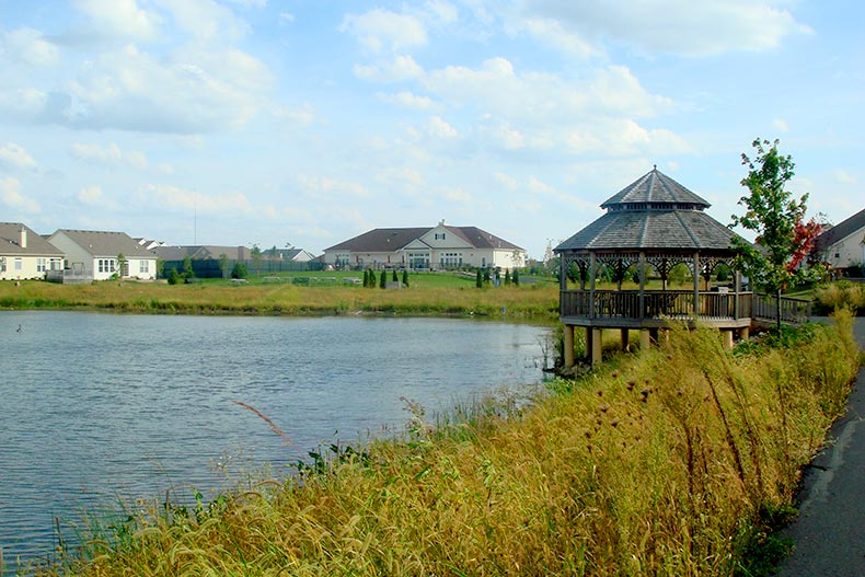 View of the pond, gazebo, and homes at Carillon at Stonegate in Aurora, IL