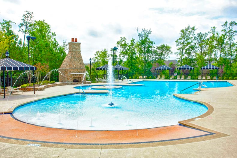 Outdoor pool with water features at Carolina Arbors