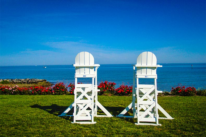Two raised chairs on lawn looking over Chesapeake Bay