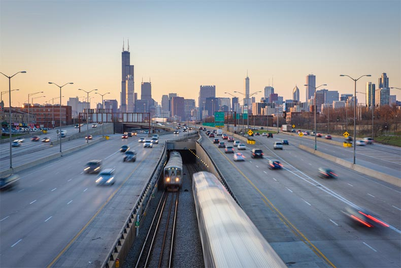 Highway and CTA trains with Chicago skyline
