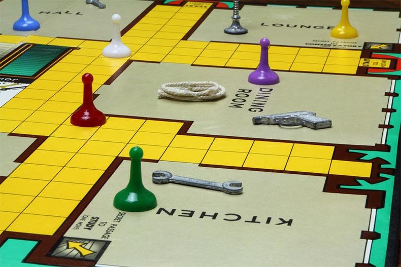 Close up of game pieces and board of Clue