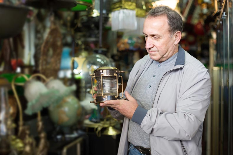 A senior man shopping for antiques at a market