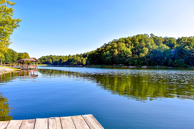View from on a dock onto a scenic lake in Connestee Falls