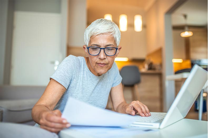 A senior woman preparing a home offer with a few contingencies