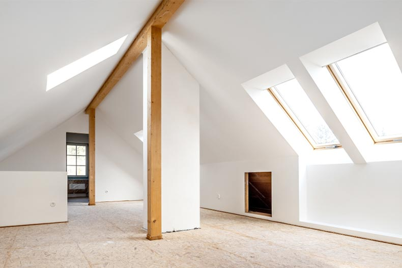 An old attic being converted into a spacious living room