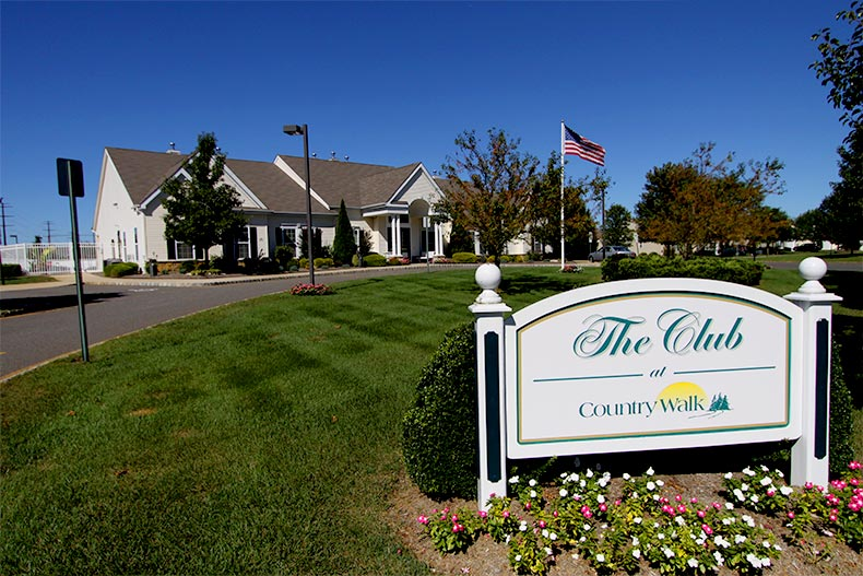 Well-manicured landscaping around the clubhouse at Country Walk of Lake Ridge in Whiting, New Jersey